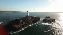 Aerial daytime flyby close up of lighthouse offshore shot Stock Footage