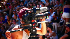 Cameraman filming Audience crowds watching Sport Festival Munich Germany Europe Stock Footage