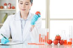 recording on clipboard of gmo food research - stock photo