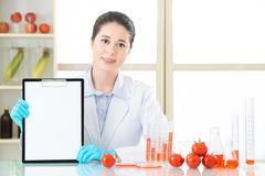 Recording genetic modification data on blank clipboard Stock Photos