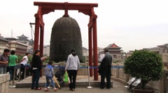 People visit Bell tower in downtown Xian, China. Stock Footage