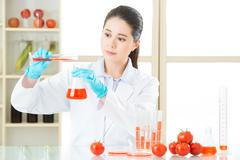 Laboratory analysis of apple gmo food for test - stock photo