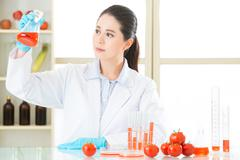 human try to make better genetic modification food - stock photo