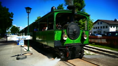 Slow-Motion Nostalgic Steam Train in Prien Chiemsee lake Germany Tourist train  Stock Footage