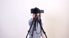 Lovely child making videos and photograps with big photo camera Stock Footage