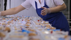 In airport factory the female worker is packing lunch boxes used in airplane Stock Footage