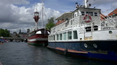 Big ships in Copenhagen canal, lighthouse boat Stock Footage