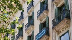 Balconies of an old building in Barcelona Stock Footage
