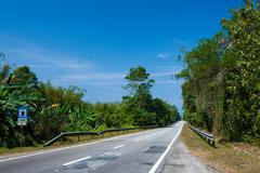 Straight road with no cars, east-west express way, gerik, Malaysia Stock Photos