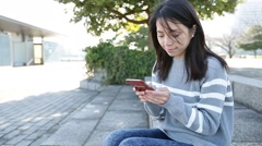 Woman using mobile phone at outdoor Stock Footage