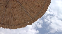 Up view of straw umbrella Stock Footage