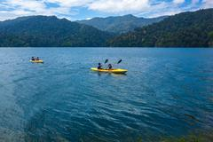 Kayaking on a tropical lake and islands in cloudy blue sky. Belum resort, Ban - stock photo