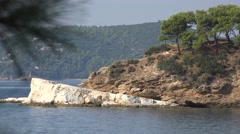 Rocky coast with pine trees in mediterranean sea Stock Footage