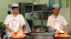 Men prepare traditional Chinese food at a street food market in Xian, China. Stock Footage