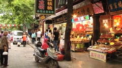People walk by a street food market in Xian, China. Arkistovideo