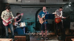 Rock band performs in underground pub Stock Footage