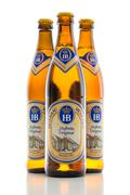 Three bottles cold light lager beer Bavarian Hofbrau Munich brewery Stock Photos