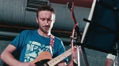 Guitarist performs in underground club Stock Footage
