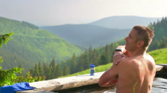 Adult Man Washing in the Nature Stock Footage