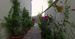 Typical Andalusian street of a village in the south of Spain. Slow motion. Stock Footage