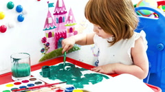 Little girl paint with gouache. Stock Footage