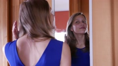 Beautiful teenager girl looking in the mirror. 4K UHD Stock Footage