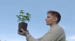 Man holding plant Stock Footage