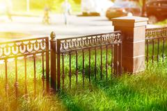 Horizontal park fence border bokeh with light leak background Stock Photos
