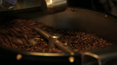 Artisan Coffee Roaster close up of beens being roasted shot - stock footage