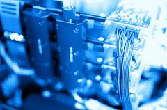 Horizontal blue gpu quad sli video card bokeh background Stock Photos