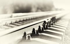 Diagonal sepia railway bokeh background Stock Photos