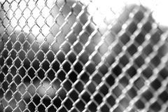 Horizontal black and white jail rabitz bokeh background - stock photo