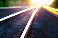 Diagonal burning sunset railway bokeh background Stock Photos