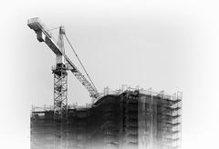 Black an white construction crane building city house background Stock Photos