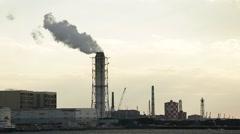 Smoking power plant - stock footage