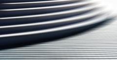 Horizontal vibrant white business stairs motion blur abstraction - stock photo
