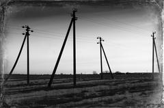 Vintange postcard sunset power lines landscape background Stock Photos