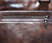 Horizontal brown leather case with zipper background - stock photo