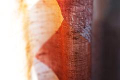 Vertical brown red vintage textured curtain backdrop - stock photo
