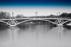Black and white dramatic arc bridge in Moscow park with blue sky Stock Photos