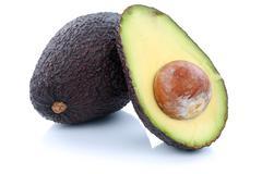 Avocado avocados fruit sliced half fruits isolated on white Stock Photos