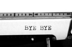 Typewriting on an old typewriter. Typing text: bye bye Stock Photos
