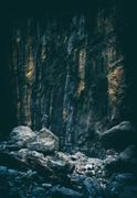 Vertical vintage pale stone rock mountain texture backdrop Stock Photos