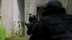 Close up A Special Force Squad storm in a house. Stock Footage