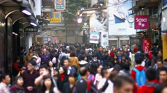 Dense pedestrian traffic in Macau's crowded, downtown district, with sound Stock Footage