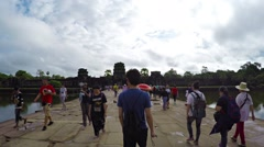 Abstract, timelapse clip of tourists swarming at Angkor Wat Stock Footage