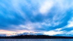 Horizontal vivid ocean cloudscape horizon land Stock Photos
