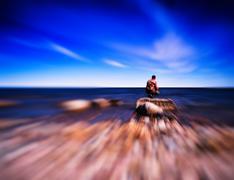 Man ocean horizon motion abstraction Stock Photos