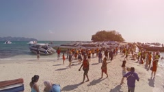 Many tourists enjoying the tropical sandy beach at Tup island in Thailand Stock Footage