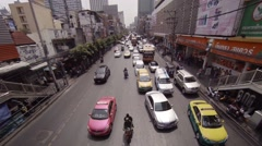 Overlooking shot of typical traffic on an urban street in Bangkok Stock Footage